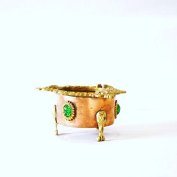Rare Victorian Inlay and engraved, Copper and Brass ashtray with claw footed arms and embellished green glass