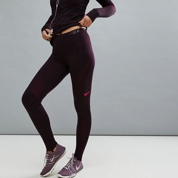 Nike Pro Hyperwarm Tight In Burgundy at asos.com