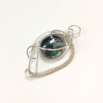 Wire wrapped pendant with an emerald green shimmering glass stone, glass pendant, sparkling necklace