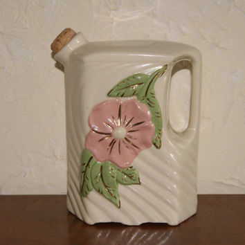 Vintage Ceramic Pottery Water Jug Or Pitcher circa 1900s White swirl With Embossed Flower Unmarked