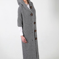 Hand knitted coat with hood and short sleeves. Large wooden buttons. Handmade cable knit.