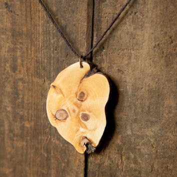 Rhododendron knot wood slice pendant on natural hemp cord necklace.  Eco wooden necklace