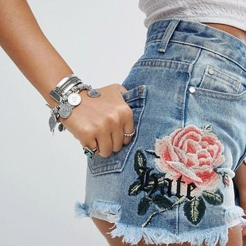 Missguided Sinner High Waisted Floral Embroidered Denim Short at asos.com