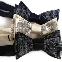 Apollo Cockpit men's bow tie. Silkscreened necktie, dove gray print. Freestyle and adjustable. Your choice of colors.