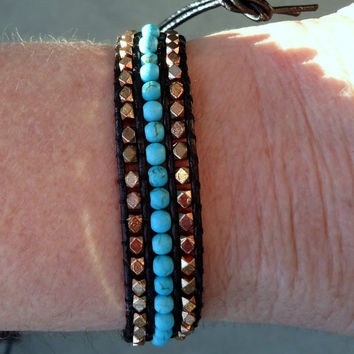 Black leather wrap bracelet  with malachite in between copper beads  and  silver tone metal button.