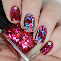 "Nail polish - ""The Unloved"" pink, silver and red glitter in a dark red jelly base"