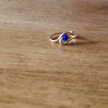 gold nose ring with cobalt blue bead (24 gauge)
