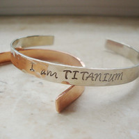 I am Titanium strength silver hammered hand stamped cuff bracelet