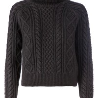 Side Slope cable knit roll neck sweater