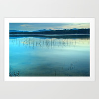 Blue sunset at the lake Art Print by Guido Montañés
