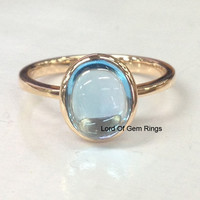 Oval Sky Blue Topaz Solitaire Bezel Set Engagement Ring 14K Rose Gold