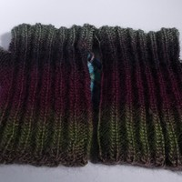 Adult hand knitted reversible wrist warmers.