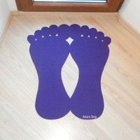Feet rug silhouette. Elegant and modern rug with feet shape.