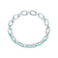 "Tiffany & Co. - Tiffany Blue® clasping link bracelet in silver with enamel finish, 7.5"" long."