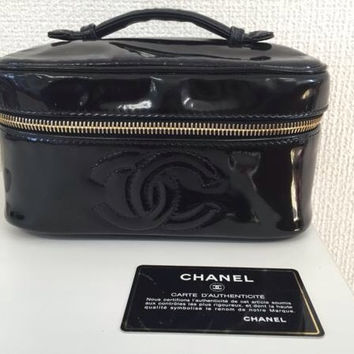 Vintage CHANEL patent enamel cosmetic and toiletry black pouch purse with CC charm. Very chic vanity purse for many use.