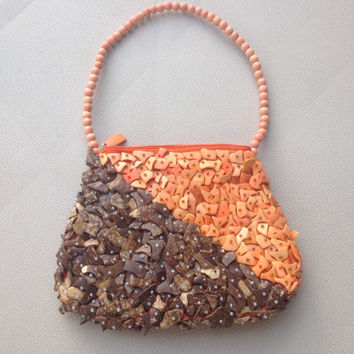 Mido Collection Purse with Coconut, Wood, And Seashell Beading in Coral and Brown