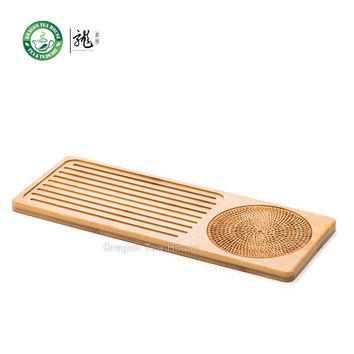 Bamboo serving tray with rattan weaving cushion.