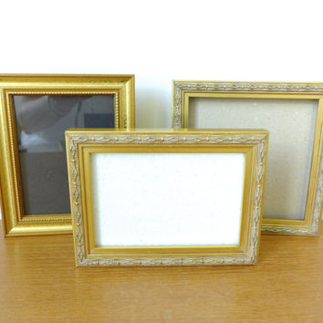 Three small gold wood picture frames