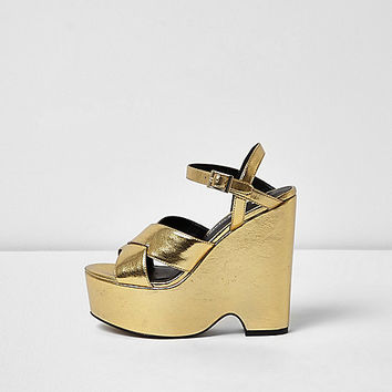 Gold cross strap platform wedges