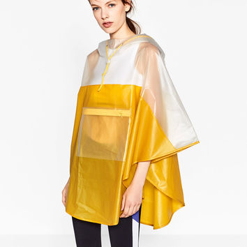 SHEER PONCHO DETAILS