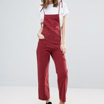 ASOS TALL Denim Jumpsuit in Raspberry With Tie Straps at asos.com