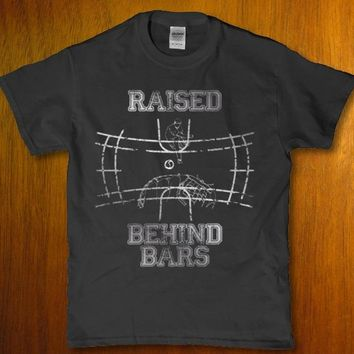 Raised behind bars funny hockey player Men's t-shirt