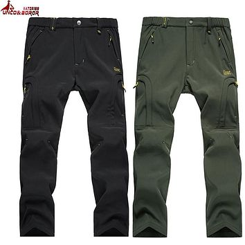 UNCO&BOROR Shark Skin Softshell Outwear Tactical Pants Men women Winter Waterproof Thermal Camo Fleece Pants brand male Trousers
