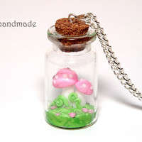 Pink mushrooms in a glass jar necklace