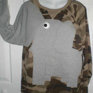 Long sleeve camo shirt with an elephant front and trunk sleeve, adult size medium
