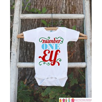 Novelty Kids Christmas Outfit - Santa's Number One Elf Shirt - Christmas Shirt for Baby Boy or Baby Girl - Funny Humorous Christmas Onepiece