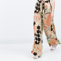 PRINTED LOOSE-FIT TROUSERS New