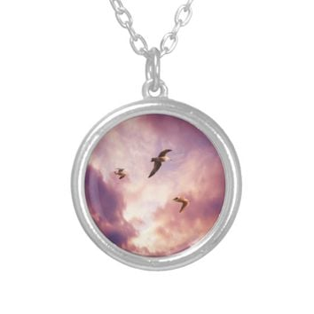 Seagulls flying in a sunset sky silver plated necklace