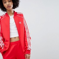 adidas Originals adicolor Three Stripe Track Jacket In Red at asos.com