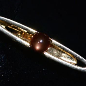SWANK Vintage tie tack in gold tone with brown glass stone