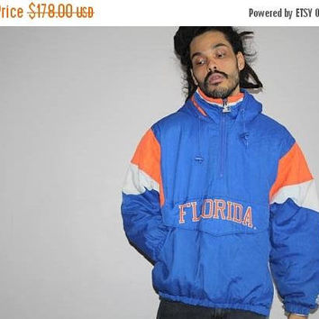 On SALE 55% Off - 1990s Florida Gators NCAA Football Hooded Spell-out Korea Made Starter Pullover Bomber Puffer Jacket -  Starter Jackets -