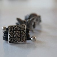 woman fashion leather ring.