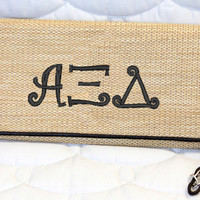 Alpha Xi Delta Bamboo Wristlet Clutch with Curlz font