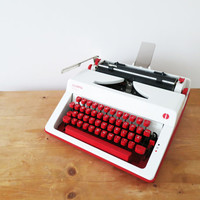70s Vintage Red Olympia Monica Manual Typewriter. Central Europe Qwertz Keys. In Good Working and Cosmetic Condition.