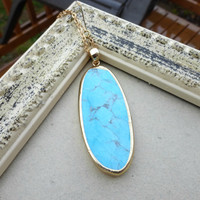 Turquoise oval stone pendant  electroplated in gold, gold chain necklace. Bohemian jewelry.