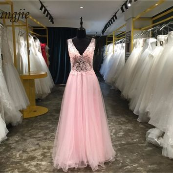 A-Line Prom Dresses 2018 Deep V-Neck Sleeveless Backless Floor Length Tulle and Applique Crystals Evening Party Gown Custom Made