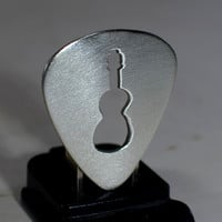 Sterling silver guitar pick with guitar cut out by artist Nici Laskin