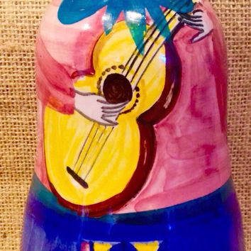 Guitar player bottle with cork hat