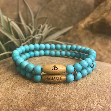 Namaste turquoise beaded stretch bracelet. Great gift for yoga teacher or persons seeking spiritual enlightenment
