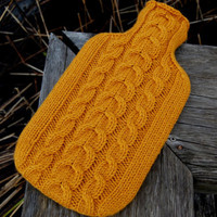 Hand knitted hot water bottle cover with cable