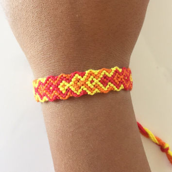Fire colored arrowhead adjustable friendship bracelet