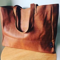 Tan real leather shoulder tote.Traditional and classic, genuine leather tote shoulder bag has long strong straps,generous size shopper.