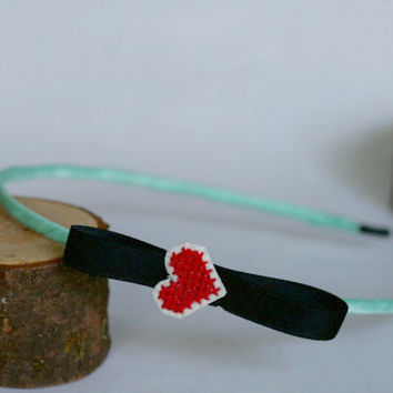 Adult red cross-stitch heart on white or black loop bow ribbon-wrapped skinny metal headband, handmade using recycled materials