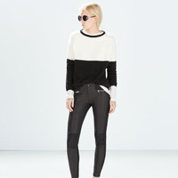 Mixed fabric faux leather biker trousers