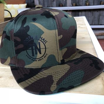 Camo snap back hat with TN logo