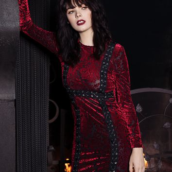 Lady in Red Velvet Dress with Long Sleeves